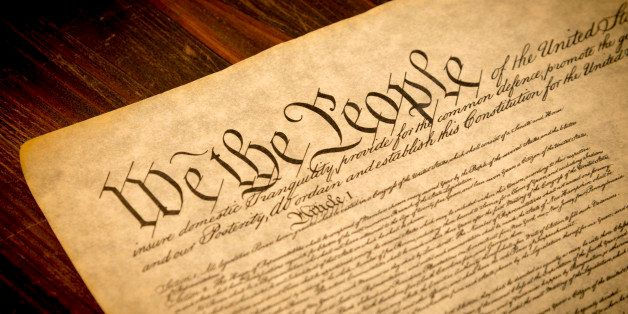 The Constitution of the United States of America on a wooden desk