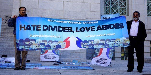 LOS ANGELES, UNITED STATES - DECEMBER 13: Protesters hold a banner written 'Hate divides, love abides' on it as hundreds of C