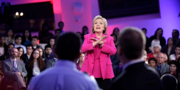 Democratic presidential candidate Hillary Clinton speaks during in a televised town hall meeting with Senator Bernie Sanders