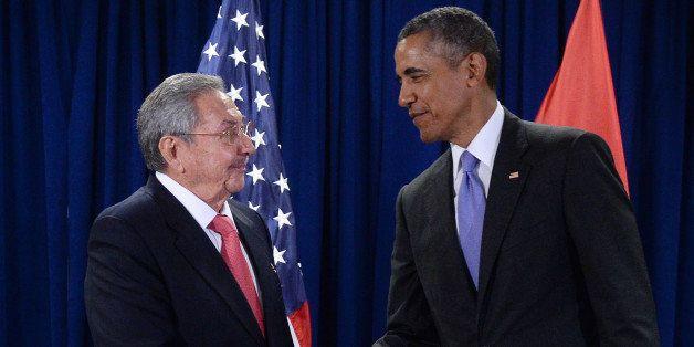 NEW YORK, NY - SEPTEMBER 29: U.S. President Barack Obama (R) and President Raul Castro (L) of Cuba shake hands during a bilat