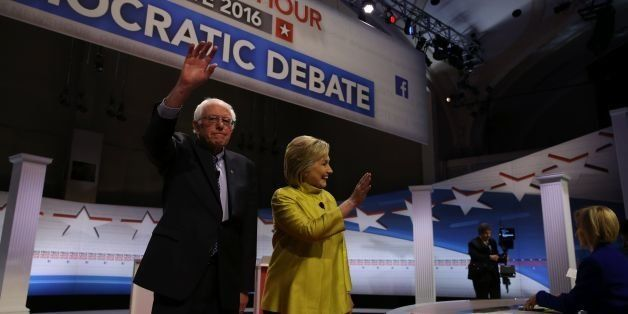 US Democratic presidential candidates Hillary Clinton and Bernie Sanders greet the audience before the PBS NewsHour President