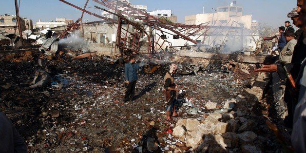 Yemenis inspect the damage at a sewing workshop that was hit by a Saudi-led coalition air strike in the capital Sanaa, on Feb