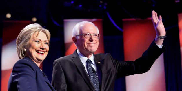 Democratic presidential candidates Hillary Clinton, left, and Sen. Bernie Sanders, I-Vt, pose for a photo before debating at