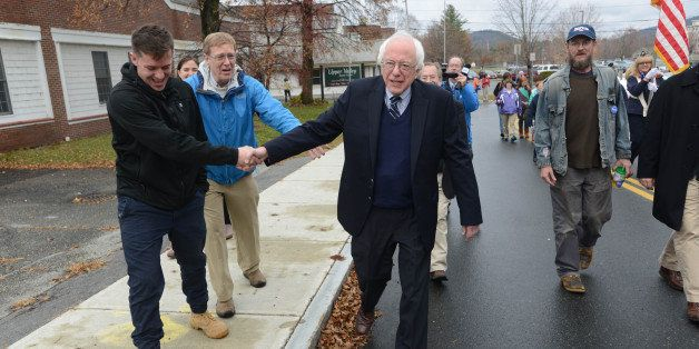 LEBANON, NH - NOVEMBER 11: Presidential candidate Bernie Sanders (I-VT) shakes hands with people as he marches in the Veteran