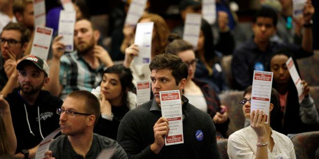 Presidential preferences cards are held up as votes are counted during a Democratic caucus at the University of Nevada Saturd