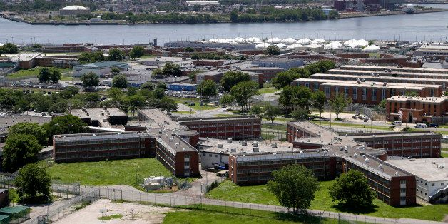 FILE- This June 20, 2014 file photo shows the Rikers Island jail with the New York skyline in the background.  New York Mayor