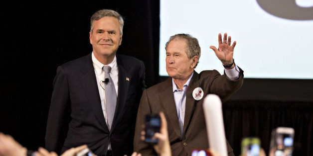 George W. Bush, former U.S. president, right, stands with his brother Jeb Bush, former Governor of Florida and 2016 Republica