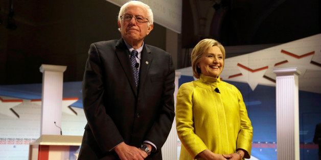 Democratic presidential candidates Sen. Bernie Sanders, I-Vt, left, and Hillary Clinton take the stage before a Democratic pr