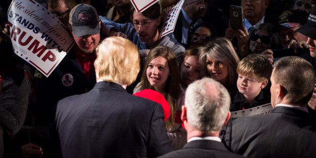 MILLINGTON, TN - FEBRUARY 27: People reach for signatures, photos, and handshakes as republican presidential candidate Donald