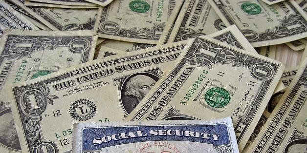 A social security card on a bed of money
