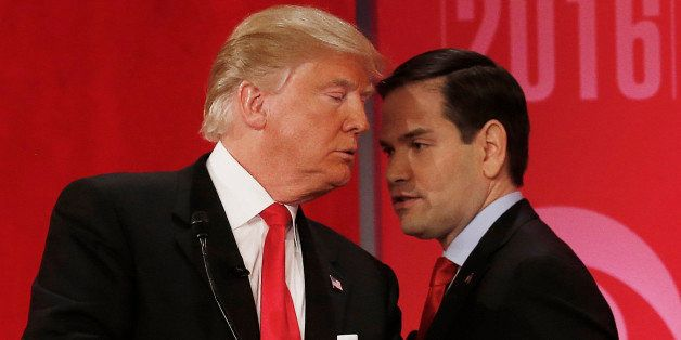 Republican presidential candidate, Sen. Marco Rubio, R-Fla., right, right, speaks to Republican presidential candidate, busin