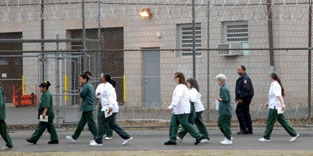 Women walk on a road at the women-only Taconic Correctional Facility in Bedford Hills, N.Y., Wednesday, March 28, 2012.   (AP
