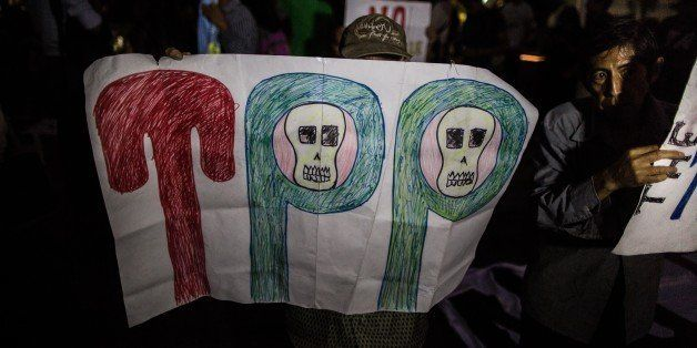 LIMA, PERU -  FEBRUARY 25 :  Demonstrators participate in a protest against the signing of the Trans-Pacific Partnership (TPP