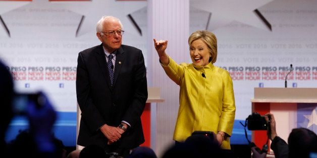 Democratic presidential candidates Sen. Bernie Sanders, I-Vt, left, and Hillary Rodham Clinton take the stage before a Democr