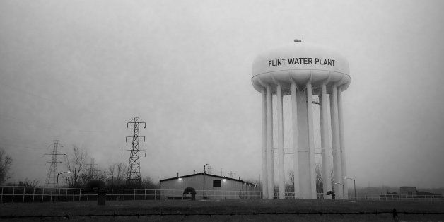 This Jan. 21, 2016 photo shows the water tower at the Flint, Mich., water plant. Flint's mayor has floated a shockingly hig
