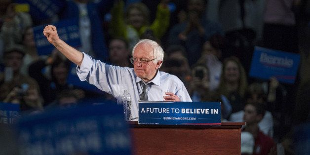 Senator Bernie Sanders, an independent from Vermont and 2016 Democratic presidential candidate, raises his fist after speakin