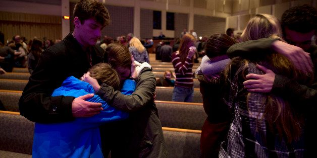 KALAMAZOO, MI - FEBRUARY 21:  People gather and pray at Center Point Church following a mass shooting on  February 21, 2016 i