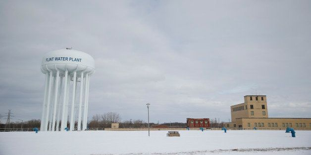 The Flint Water Plant tower is seen, Friday, Feb. 26, 2016 in Flint, Mich. Flint is under a public health emergency after its