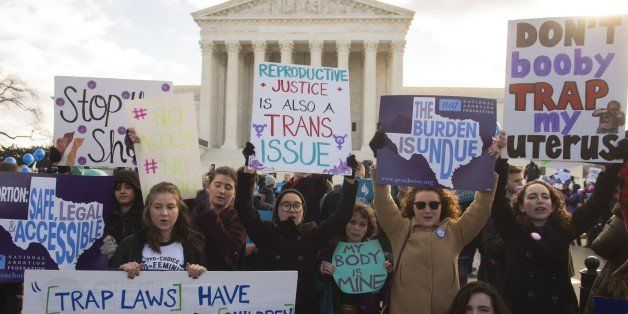 Supporters of legal access to abortion, as well as anti-abortion activists, rally outside the Supreme Court in Washington, DC