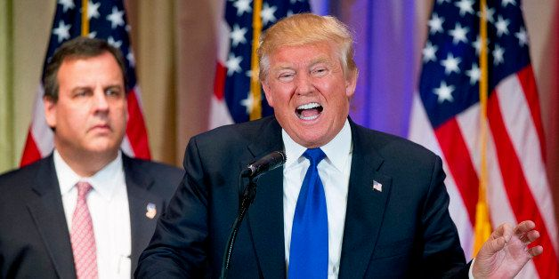 Republican presidential candidate Donald Trump, accompanied by New Jersey Gov. Chris Christie, left, speaks during a newsconf