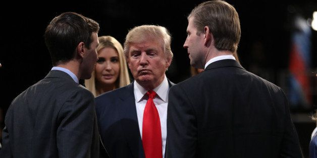 Republican U.S. presidential nominee Donald Trump (C) is greeted by (L-R) his son-in-law Jared Kushner, daughter Ivanka and s