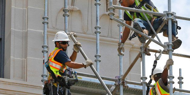 Workers build scaffolding at the state Capitol in Oklahoma City, Thursday, June 11, 2015. Assessments and test phases of exte