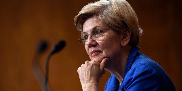 Sen. Elizabeth Warren, D-Mass., listens to Federal Reserve Chair Janet Yellen testify before the Senate Banking, Housing, Urb