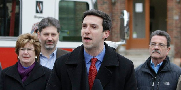 FILE - In this Feb. 19, 2013 file photo, Cincinnati City Councilman P.G. Sittenfeld, front, speaks during a news conference i