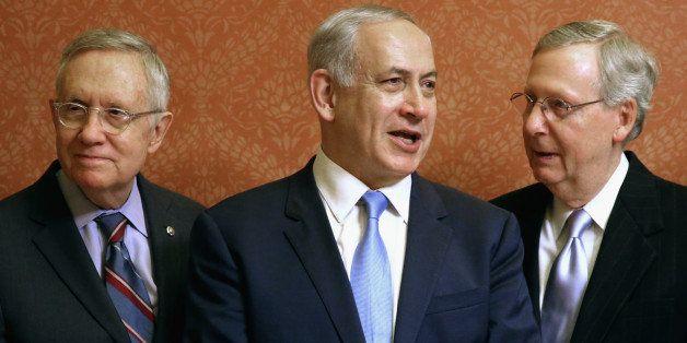 WASHINGTON, DC - NOVEMBER 10:  Israeli Prime Minister Benjamin Netanyahu (C) poses for photographs with U.S. Senate Majority