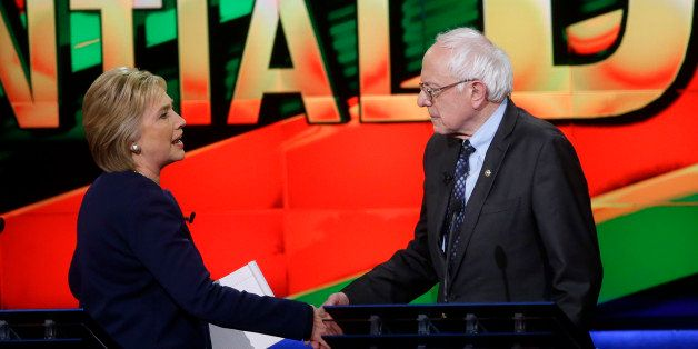 Democratic presidential candidates, Hillary Clinton and Sen. Bernie Sanders, I-Vt., right, shake hands at the end of a Democr