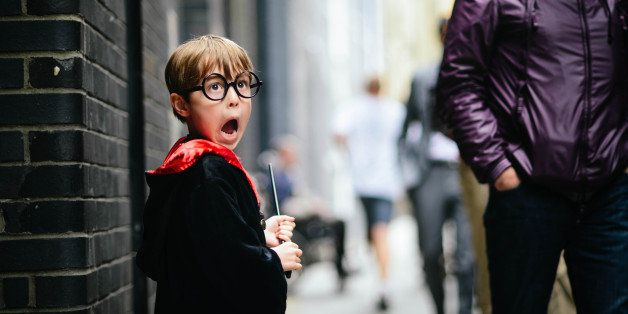 Boy, pretending to be Harry Potter. He is carrying a wand and has his mouth wide open as he pretends to see a Dementor.