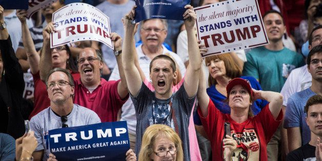 ORLANDO, FL - MARCH 5: Supporters cheer as republican presidential candidate Donald Trump speaks during a campaign event at t