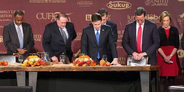 DES MOINES, IA - NOVEMBER 20:  Republican presidential candidates (LtoR) Ben Carson, Mike Huckabee, Sen. Marco Rubio (R-FL),