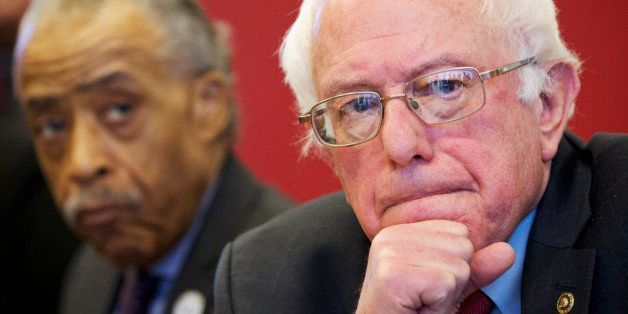Democratic presidential candidate, Sen. Bernie Sanders, I-Vt., accompanied by Rev. Al Sharpton, President of the National Act