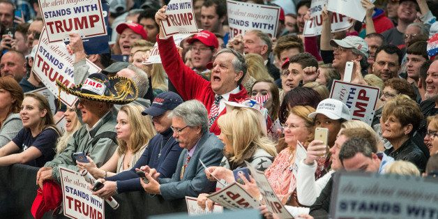 CONCORD, NC - MARCH 7: Donald Trump supporters cheer on the Republican presidential candidate before a campaign rally March 7