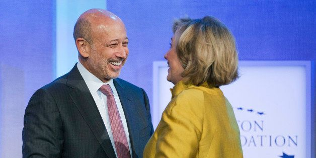 Lloyd Blankfein, left, Chairman and CEO of Goldman Sachs, is greeted by Hillary Rodham Clinton, former Secretary of State, fo