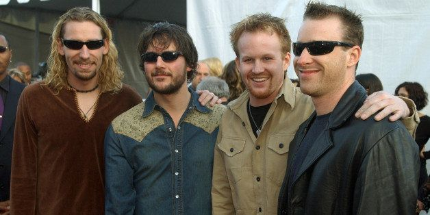 Canadian rock group Nickelback arrives at the 30th annual American Music Awards Monday, Jan. 13, 2003, in Los Angeles. Nickel
