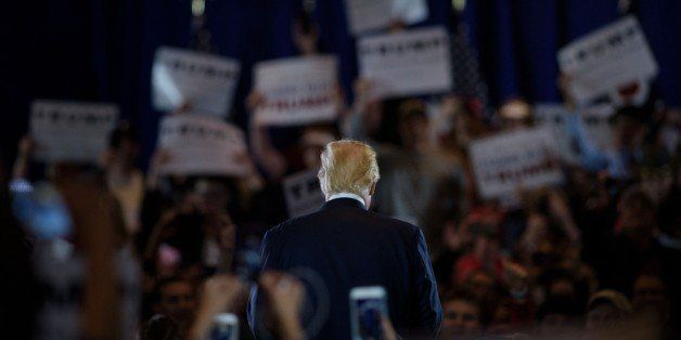 Republican Presidential hopeful Donald Trump speaks during a rally March 13, 2016 in West Chester, Ohio. / AFP / Brendan Smia