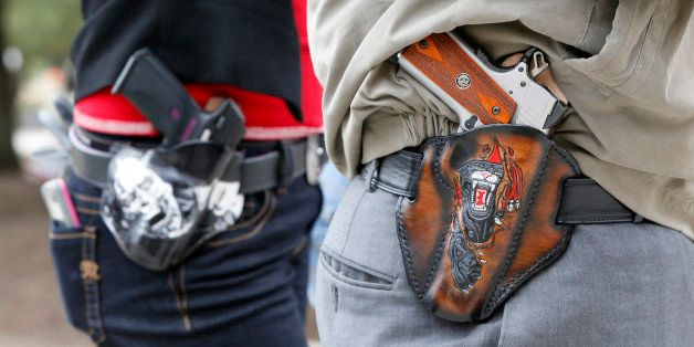 AUSTIN, TX - JANUARY 1: Art and Diana Ramirez of Austin with their pistols in custom-made holsters during and open carry rall