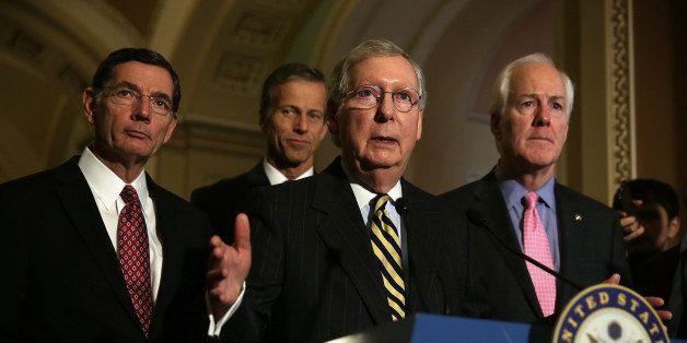 WASHINGTON, DC - MARCH 08:  U.S. Senate Majority Leader Sen. Mitch McConnell (R-KY) (3rd L) speaks as (L-R) Sen. John Barrass