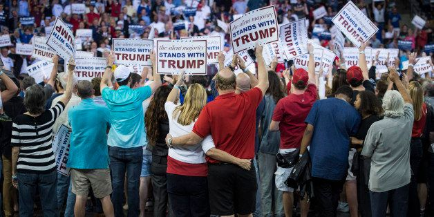 ORLANDO, FL - MARCH 5: Patrons cheer as republican presidential candidate Donald Trump speaks during a campaign event at the