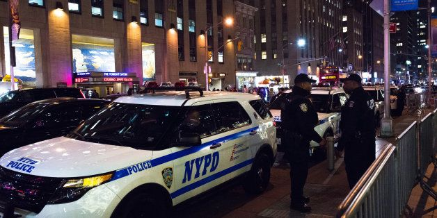 ROCKEFELLER CENTER, NEW YORK, NY, UNITED STATES - 2015/12/10: Officers from the NYPD's Strategic Response Group stand alert b
