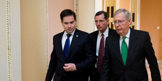 UNITED STATES - MARCH 17: From left, Sen. Marco Rubio (R-FL) speaks with Sen. John Barrasso (R-WY) and Senate Majority Leader
