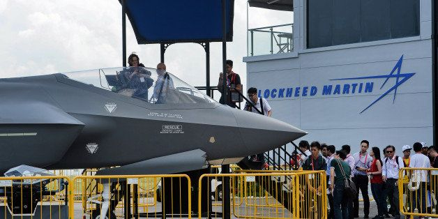 Visitors queue to have closer look at a static display of a Lockheed Martin F-35 at the Singapore Airshow in Singapore on Feb