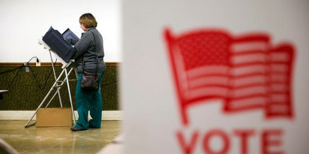 A voter casts her ballot in the primary election Tuesday, March 15, 2016, at an American Legion Hall in Marengo, Ohio. (AP Ph