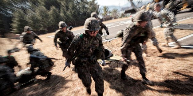 POCHEON, SOUTH KOREA - March 15: A litter team of South Korean Army rushes to a triage station carrying 'wounded' soldier fro