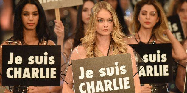 ANTALYA, TURKEY - JANUARY 9: Model Lindsay Ellingson (C) holds a sign reading 'Je suis Charlie' as she displays a creation d