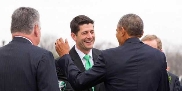 President Barack Obama, center, shares a laugh with House Speaker Paul Ryan of Wis., after walking down the steps of the Capi