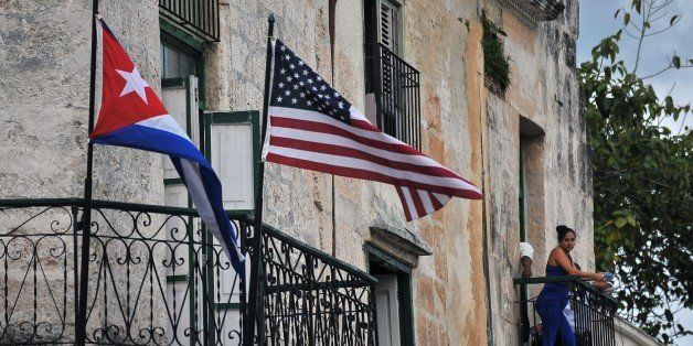 Cuban and US flags are seen on balconies in Havana on March 20, 2016. On Sunday, Obama became the first US president in 88 ye