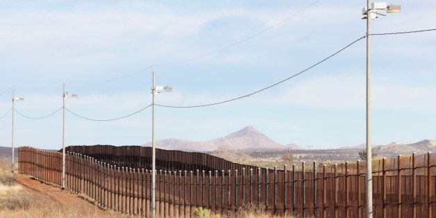 United States Mexico border fence illegal immigration barrier from the American side.